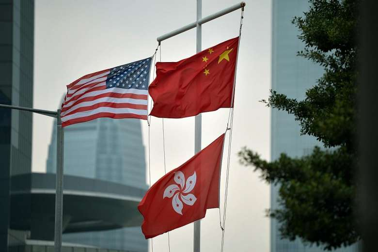 A file photo showing the Star-Spangled Banner flying together with the Hong Kong and Chinese flags in Hong Kong's Central district. Photo: Twitter