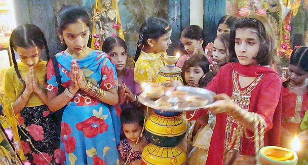 Hindu community children busy at their religious rituals. APP photo by Farhan Khan/Wikipedia