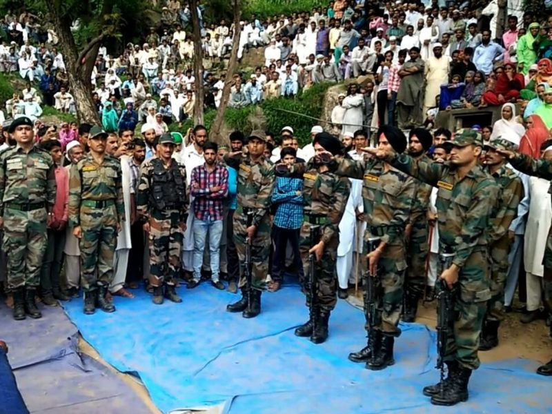 Indian soldiers and civilians pay tribute to an off-duty soldier killed by shooting from across the Line of Control between India and Pakistan, in Gulpur in Poonch district about 230km north of Jammu, during his funeral in July 2017. Photo: AFP