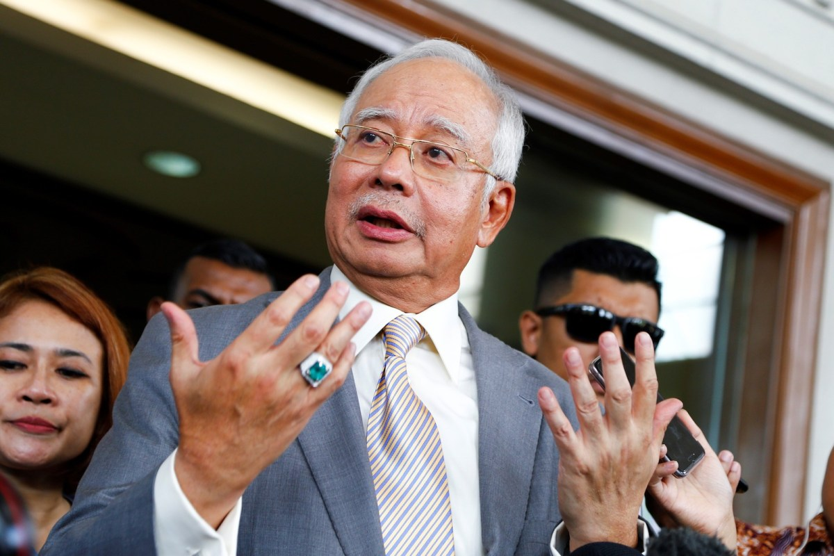 Former Malaysian Prime Minister Najib Razak talks to media at Kuala Lumpur's High Court after a hearing in the 1MDB financial fraud case on October 25, 2018. Photo: AFP via Andalou Agency/Adli Ghazali