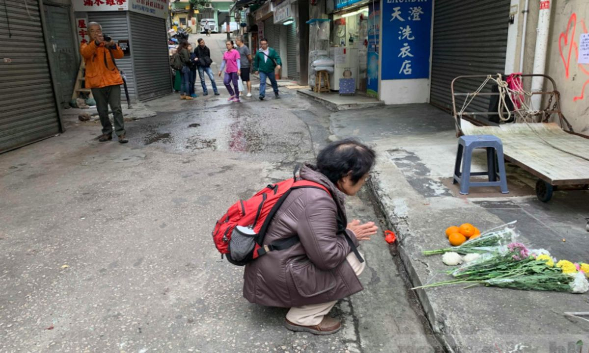 People mourn at the site of the fatal car accident in North Point, Hong Kong Island. Photo: RTHK
