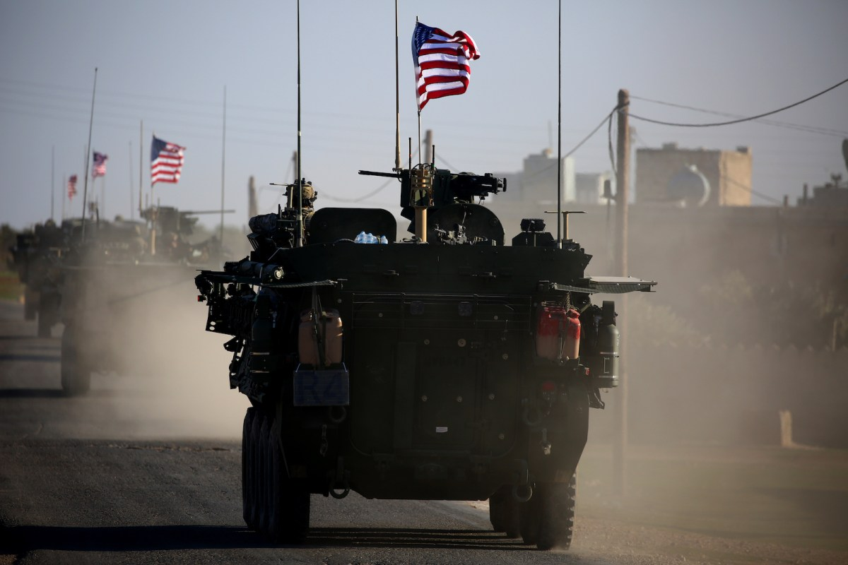 A convoy of US forces' armored vehicles near the village of Yalanli, on the western outskirts of the northern Syrian city of Manbij, in early 2018. The United States is preparing to withdraw its troops from Syria, a major move that throws into question America's role in the region. Photo: AFP/Delil Souleiman