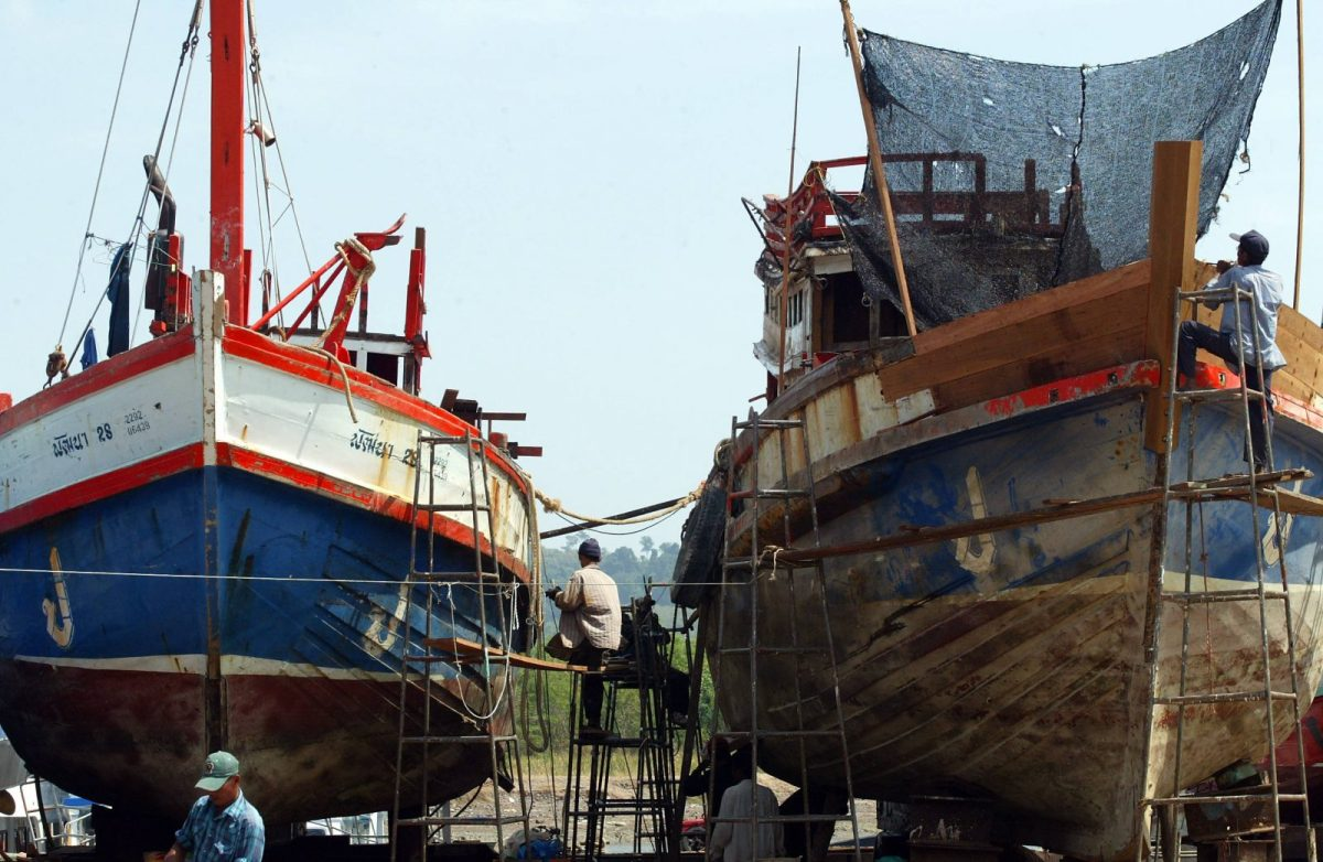 Thai workers repair fishing boats in Phuket province in January 2005. Efforts to reform the Thai fishing industry have been underway despite resistance by some involved in the business. Photo: AFP/Pornchai Kittiwongsakul