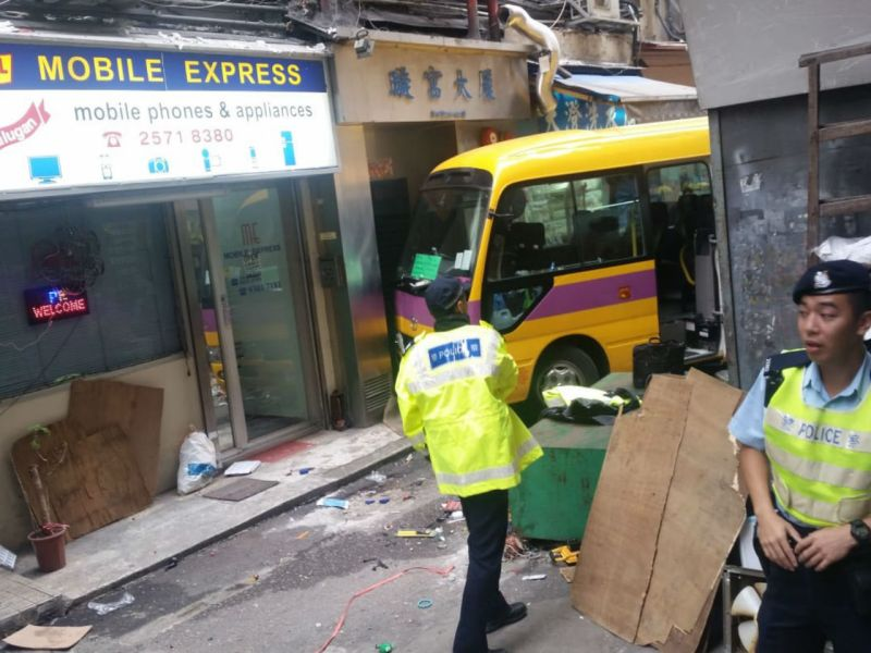 Emergency services personnel at the scene of the crash in North Point.  Photo: Asia Times