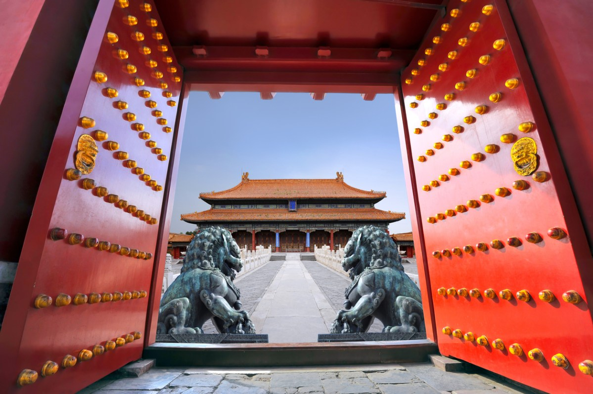 Red entrance gate opening to the forbidden city in Beijing - China. Photo: iStock