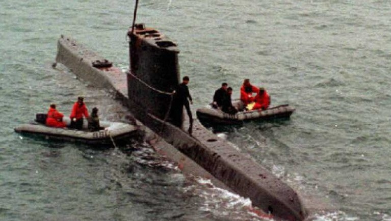 A South Korean Navy team prepares to move a North Korean mini-submarine which ran aground in September 1996. Photo: AFP