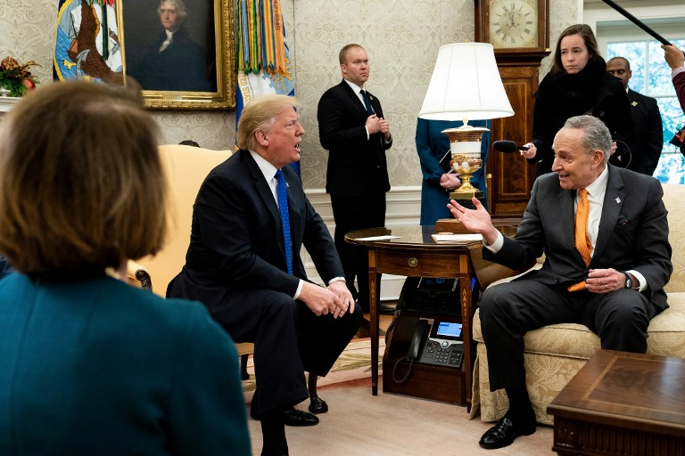 President Donald Trump and Senate Minority Leader Chuck Schumer argue before a meeting at the White House in December. Photo: AFP