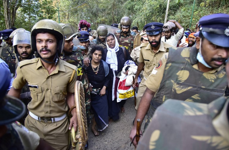 Indian police escort Hindu devotees Kanaka Durga (centre L) and Bindu (centre R) after they were stopped by hardline activists during an effort to reach the Sabarimala Ayyapa temple in the southern state of Kerala. Photo: AFP