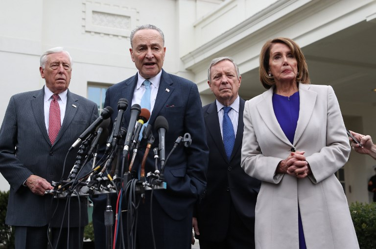 House Speaker Nancy Pelosi and Senate Minority Leader Chuck Schumer (2nd-L), speak to the media after meeting with US President Donald Trump to discuss the partial government shutdown. Photo: AFP/Alex Edelman