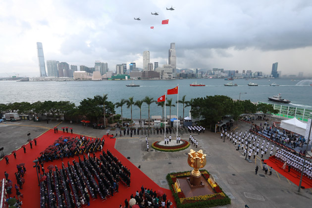 Honor guards from the Hong Kong Police Force play the Chinese national anthem during a flag-raising ceremony. Photo: Handout