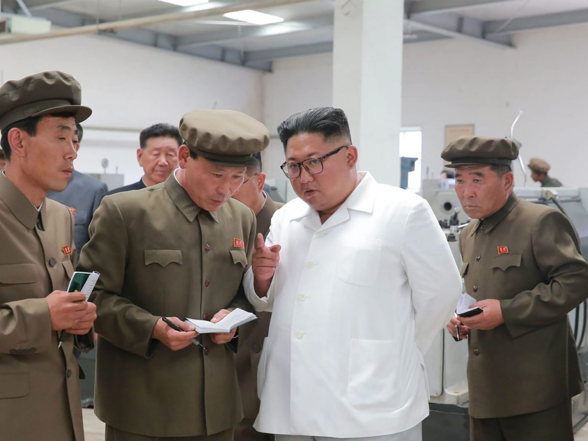 North Korean leader Kim Jong Un talks with cadres. Kim las launched another purge in the military, undermining morale. Photo: AFP/KCNA via KNS