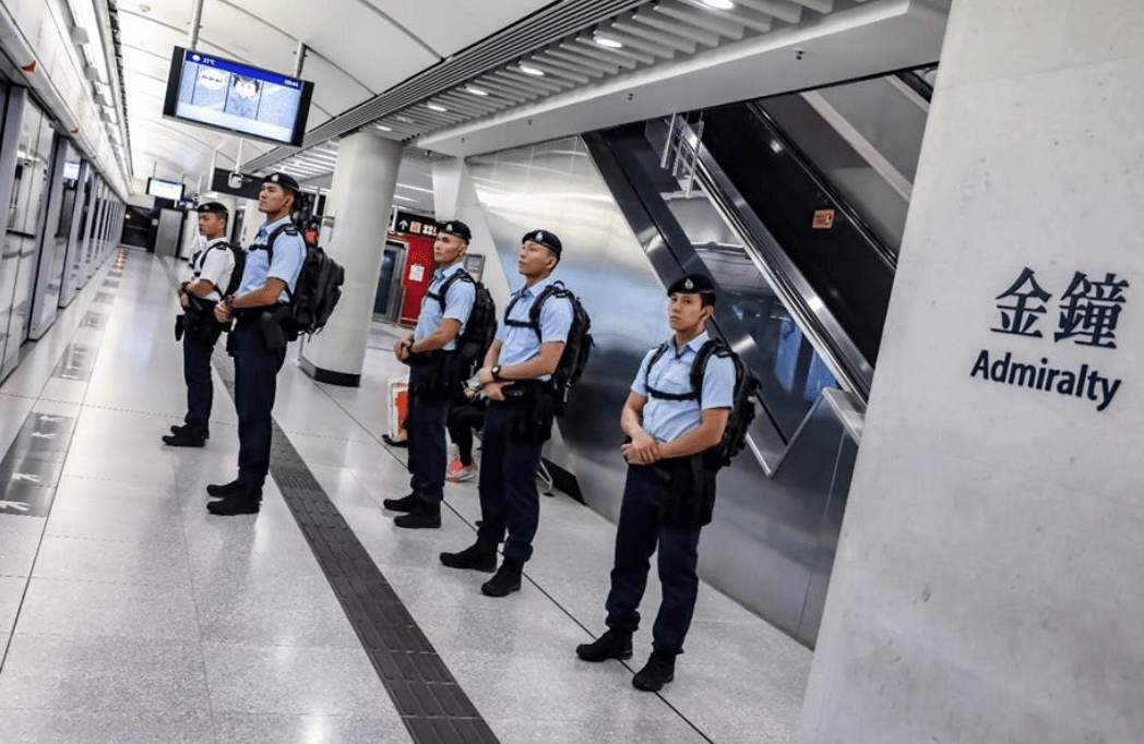 Members of the Hong Kong Police's Railway Response Team on a platform inside Admiralty Station, a major interchange for four lines. Photo: Handout