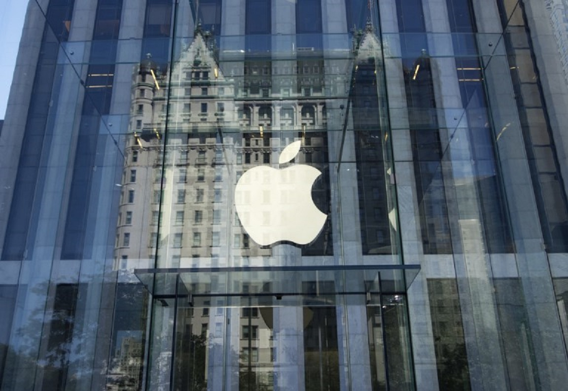 The Apple logo hangs over the entrance of one of its stores in New York. Photo: AFP