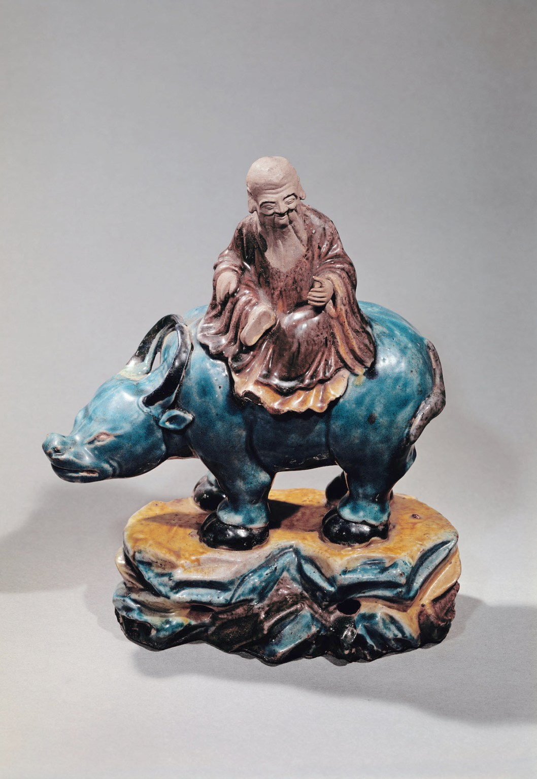 Lao-Tzu (c.604-531 BC) on his Buffalo, Qing dynasty (ceramic) by Chinese School, (18th century); Musee Guimet, Paris. Photo: AFP