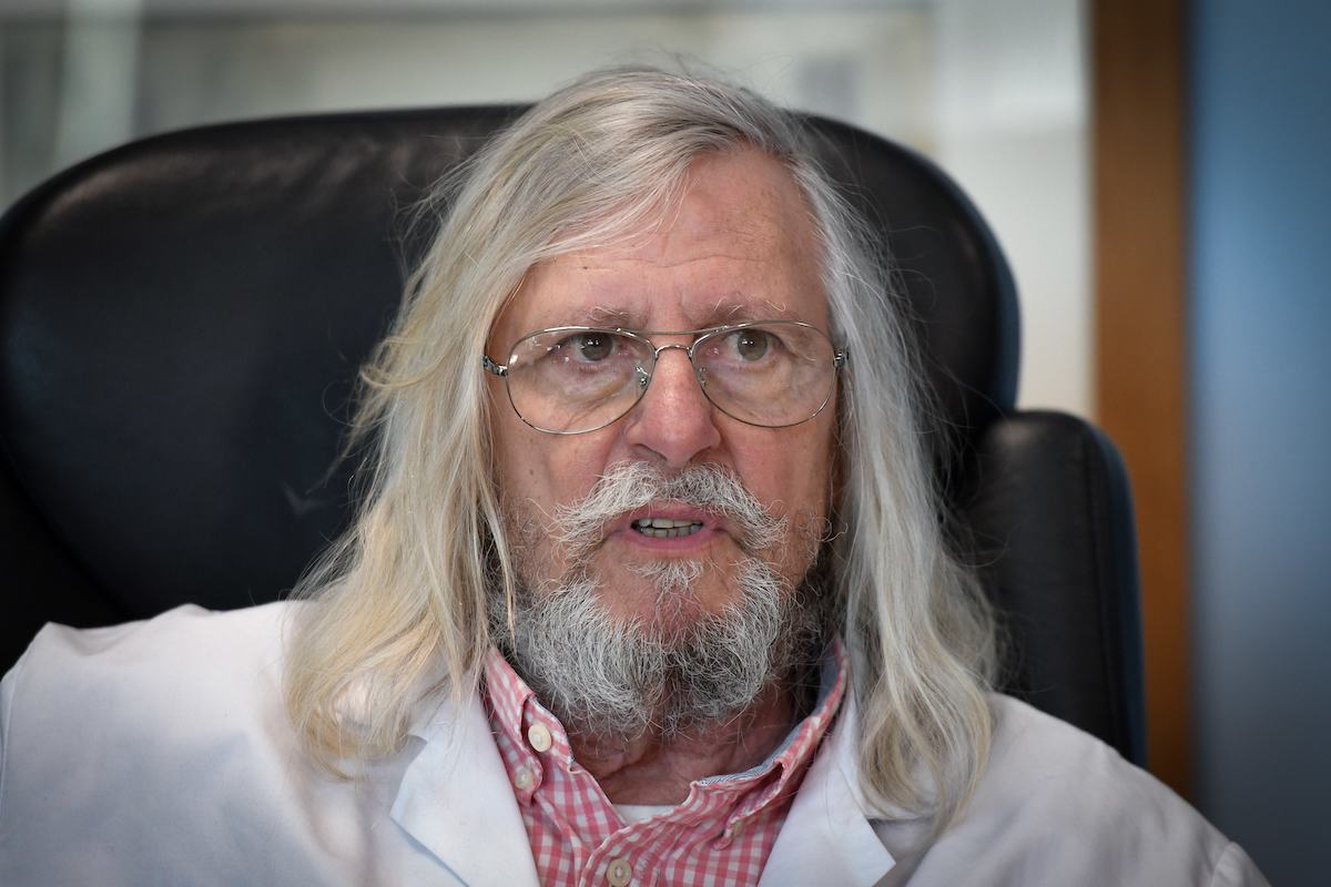 French professor Didier Raoult, biologist and professor of microbiology, specializes in infectious diseases and director of IHU Mediterranee Infection Institute, poses in his office in Marseille, France. Photo: AFP/Gerard Julien