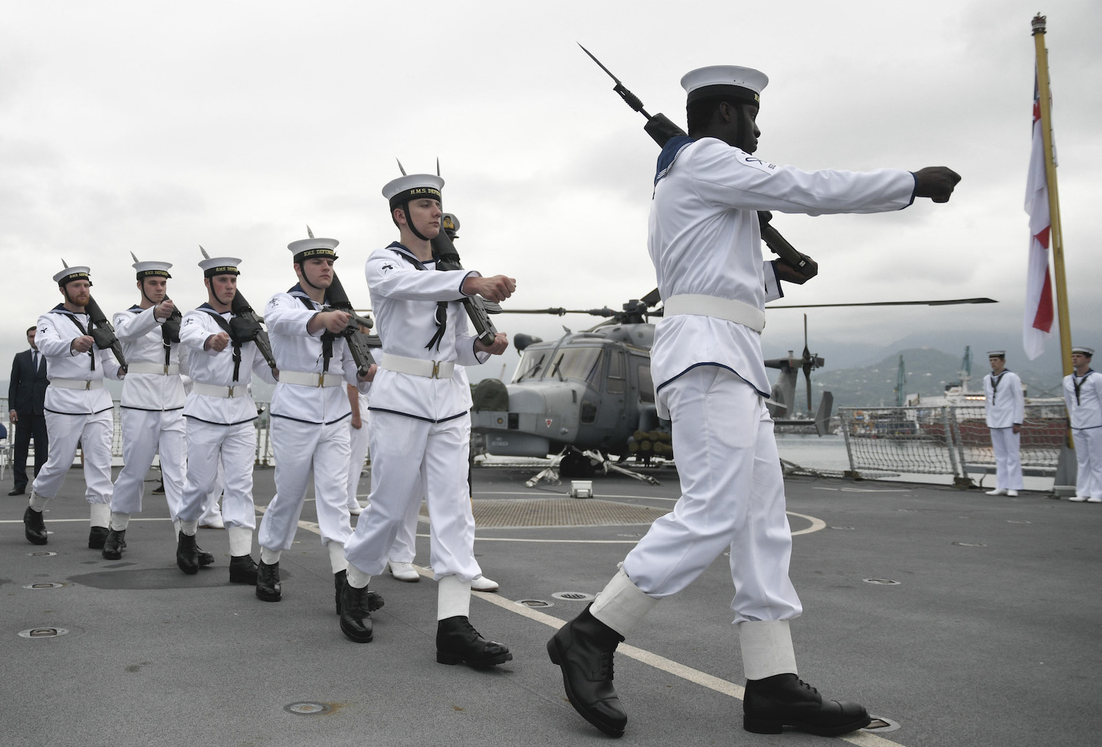British Royal Navy members marching onboard the warship HMS Defender in Georgia's Black Sea port of Batumi on June 26 as the Defender makes a port call for joint exercises with the NATO-aspirant country's coast guard. Photo: AFP / British embassy in Georgia
