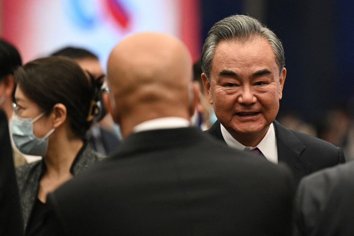 Chinese Foreign Minister Wang Yi chats with guests after the opening ceremony of the Lanting Forum in Beijing on June 25. Photo: AFP / Jade Gao