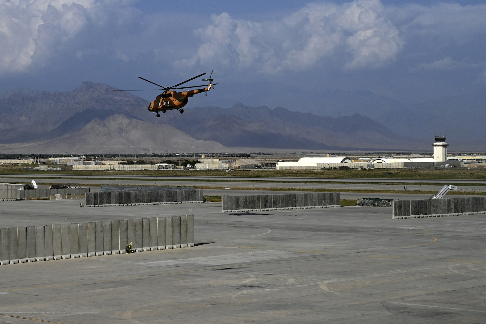 An Afghan National Army (ANA) helicopter takes off inside the Bagram US air base after all US and NATO troops left on July 5, 2021. Photo: Wakil Kohsar / AFP