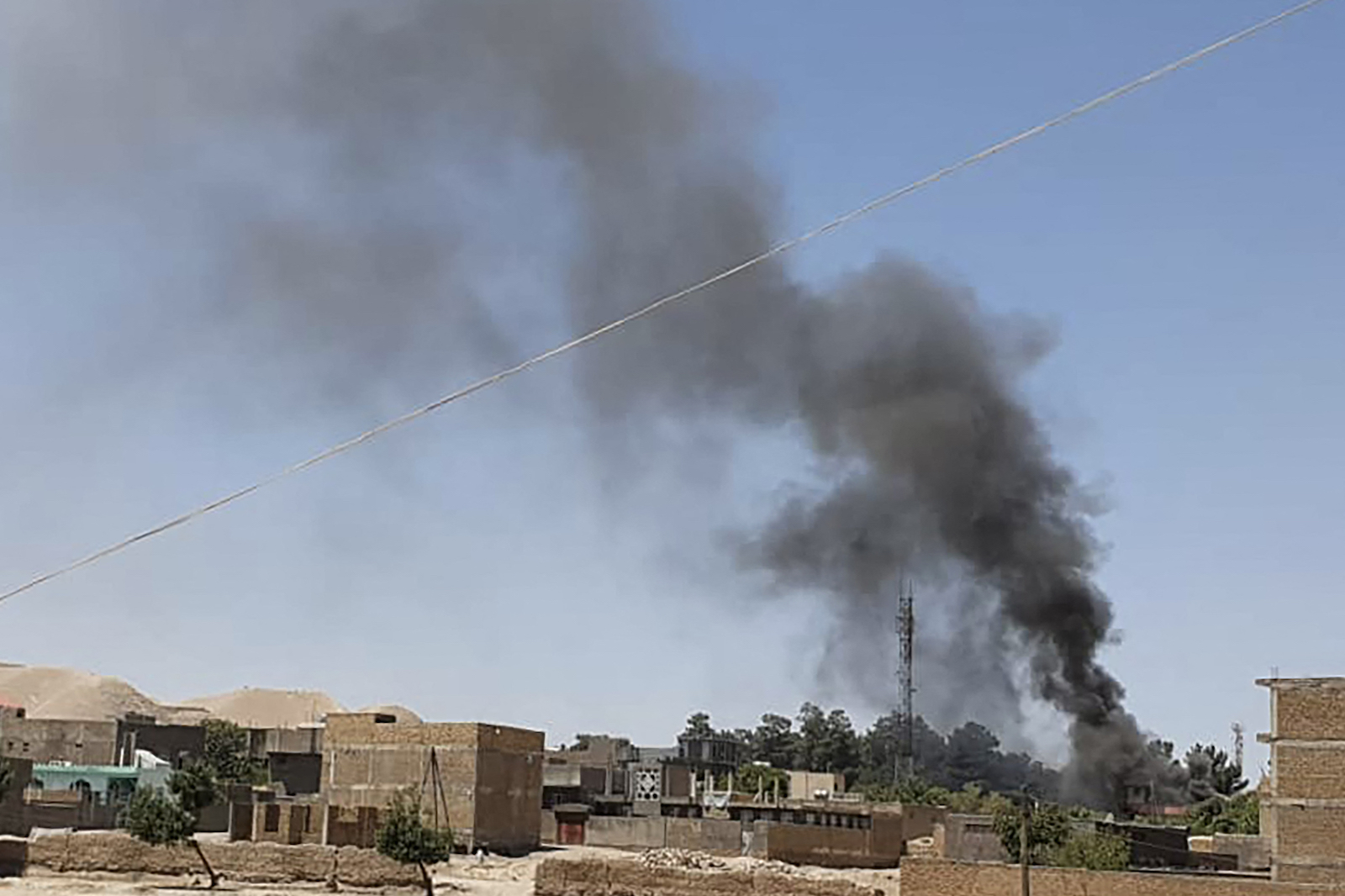 A smoke plume rises from houses amid an ongoing fight between Afghan security forces and Taliban fighters in the western city of Qala-i- Naw, the capital of Badghis province, on July 7. The Taliban launched its first major assault on a provincial capital since the US military began its final drawdown of troops from the country. Photo: AFP