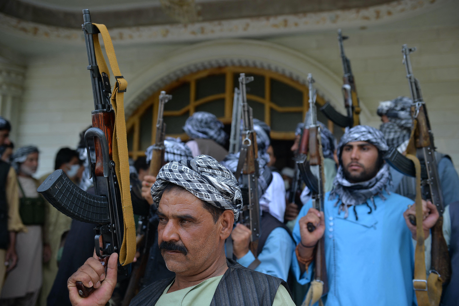 Afghan militia gather with their weapons to support Afghanistan security forces against the Taliban, in Afghan warlord and former Mujahideen leader Ismail Khan's house in Herat on July 9, 2021. Photo: AFP / Hoshang Hasimi