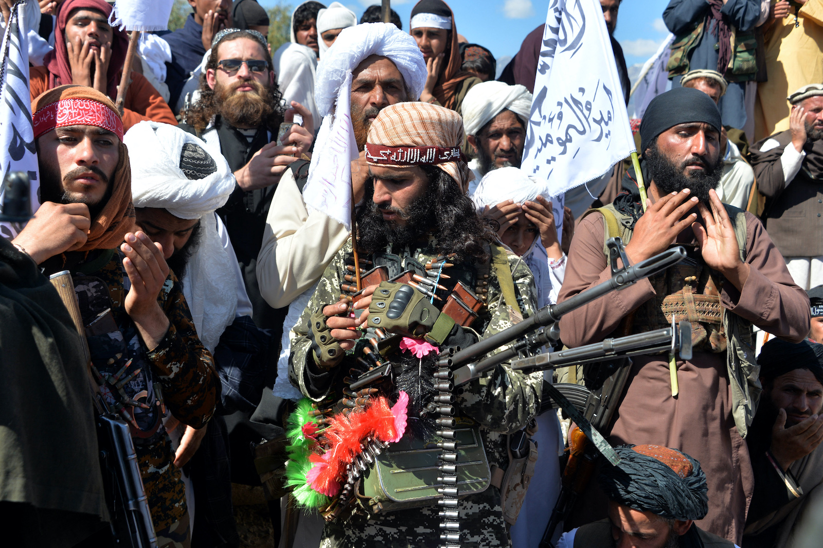 >Afghan Taliban militants and villagers attend a gathering as they celebrate the peace deal and their victory in the Afghan conflict on US in Afghanistan, in Alingar district of Laghman Province on March 2, 2020. Photo: AFP / Noorullah Shirzada