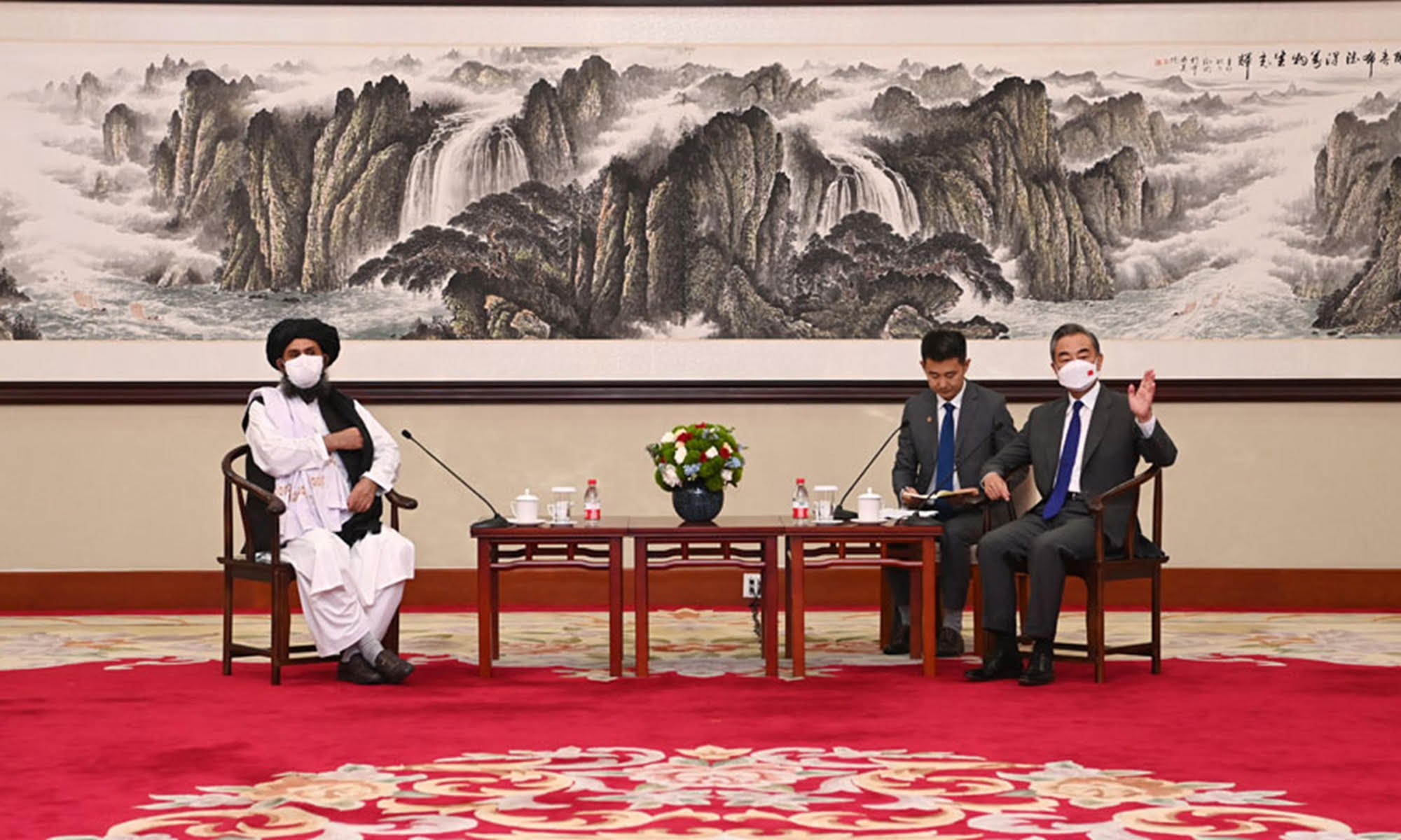 Mullah Baradar speaks with Chinese Foreign Minister Wang Yi (right foreground) in Tianjin. Photo: Chinese Foreign Ministry