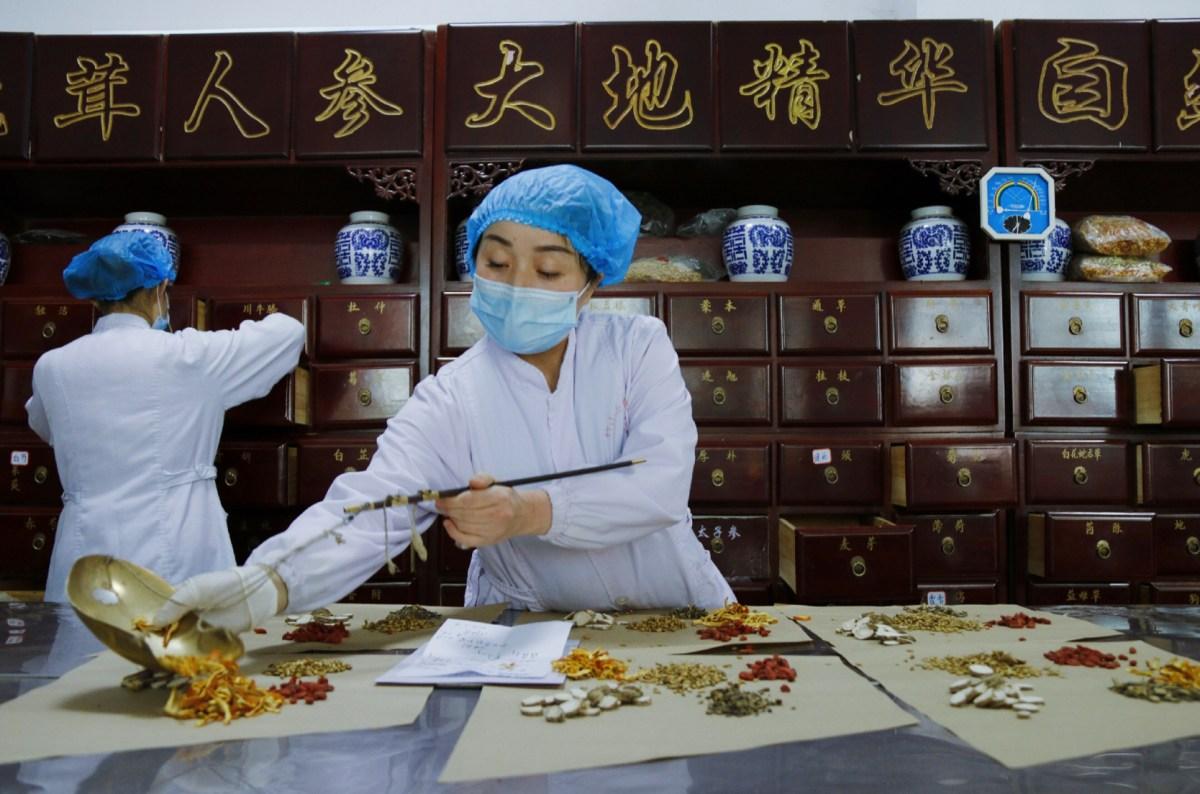 Beijing touts herbal fix for vaccine doubters