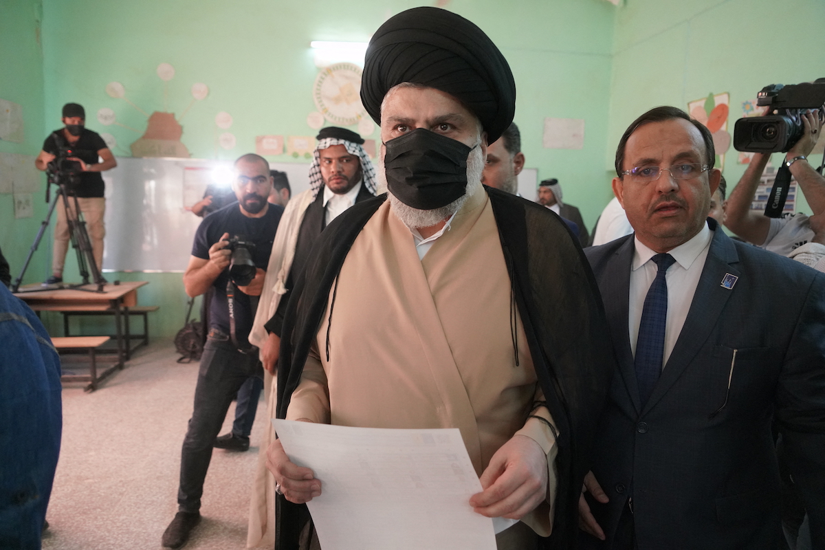 Iraq's populist cleric Muqtada al-Sadr prepares to vote at a polling station in the central Iraqi shrine city of Najaf on October 10, 2021. Photo: AFP