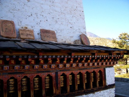 Rows of Prayer Wheels decorate the perimeter of one of the Best Places To Visit In Thimphu Bhutan, an ancient temple named Changangkha Lhakhang