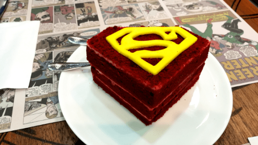 Best Places To Eat In Kuala Lumpur - DC Comics Super Heroes Cafe, Yummy and Delicious Velvet Cake with yellow Superman logo on top