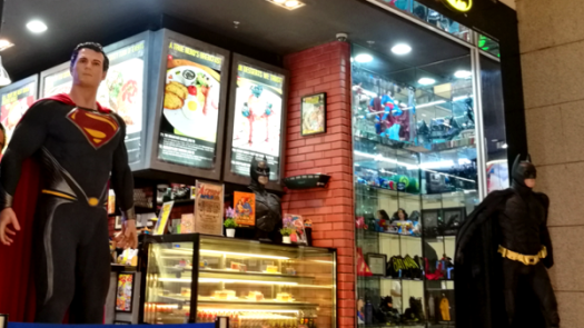 Best Places To Eat In Kuala Lumpur - DC Comics Super Heroes Cafe storefront with life size Superman and Batman guarding the entrance