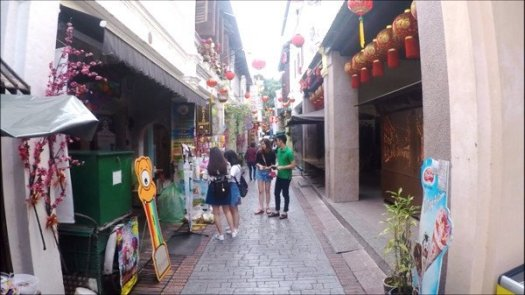 Tourists taking a stroll, slowly browsing and selecting what to eat, drink and what souvenirs to buy