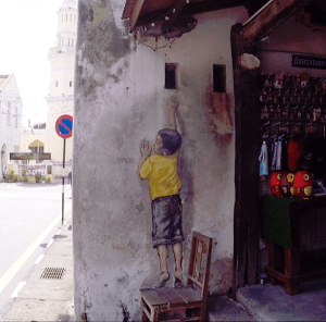 One of the famous Street Art in Penang - Boy On Chair