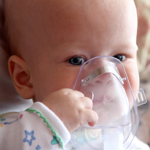 baby with nebulizer