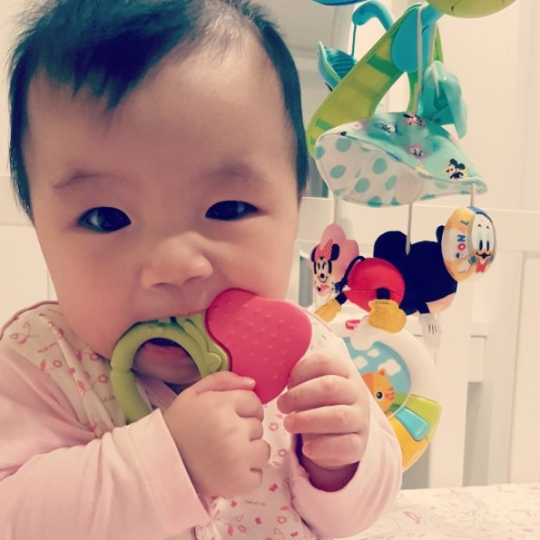 Ange Strawberry Teething Ring in Use