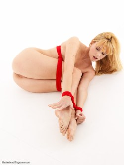 Ariel Anderssen ballgaged and naked in the legs-up balltie position