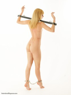 Ariel Anderssen naked, yoked and clapped in leg irons