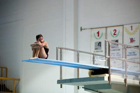 Nine year old athlete Solène Bougon rest before diving from three meter tremplin during a training with Club Aquatique Rosemont-Petite-Patrie, on Tuesday, Nov. 3, 2015, at the Rosemont Pool, in Montreal, Que. The Club of two girls and four boys trains five hours per week and participates in many competitions in Quebec throughout the years.(Marie-Pierre Savard /JOUR523)