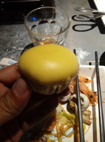 Some yummy steamed bun with sweet liquid stuff inside.