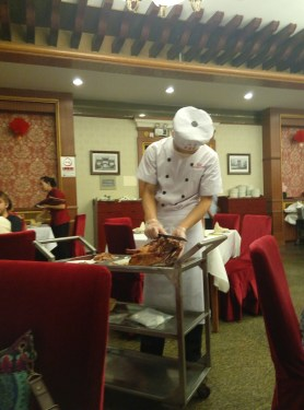This is the very famous Peking Duck (北京烤鸭) restaurant right across the Tiananmen Square. The chef comes carving the duck. The place is a bit expensive but surely worth trying it.