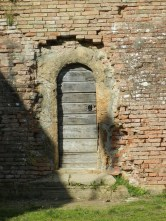 I've become a connoisseur of tiny arch ways in crumbling brick walls.