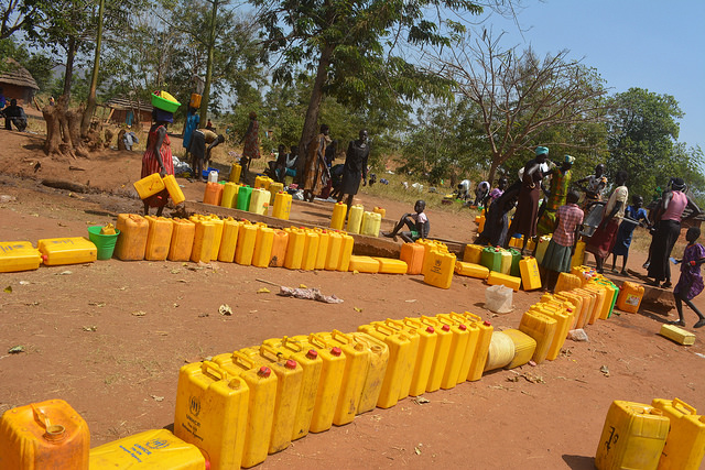 Jerry cans lined up, waiting for water, in a camp for refugees from South Sudan, in Uganda. Photo: Oxfam International / flickr