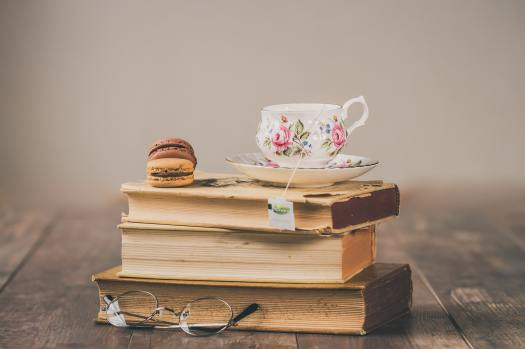 cup of tea on top of books