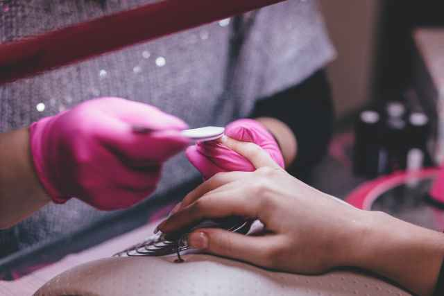 close up of woman having manicure