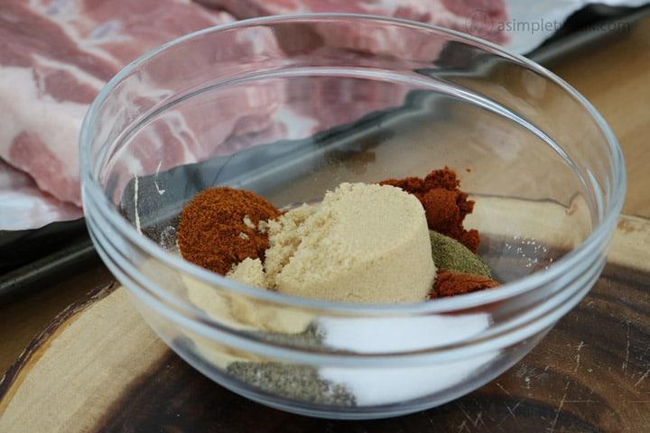 combine-smoked-paprika,-cayenne-pepper,-black-pepper,-salt,-oregano,-brown-sugar,-and-powder-garlic