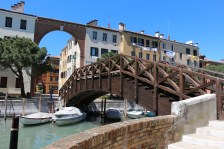 Most bridges are made of concrete. But there are occassionally a couple of wooden bridges like this that catch our eyes.