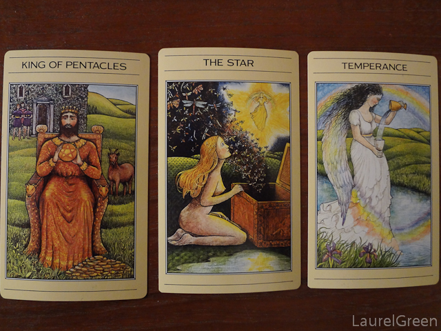a three card tarot spread with the king of pentacles, the star and temperance