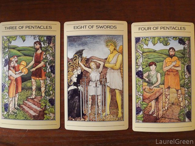 a three card tarot spread with the three of pentacles, the eight of swords and the four of pentacles
