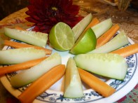 Chop carrots and cucumbers. Sprinkle lemon juice to taste. Don't eat the dahlia.