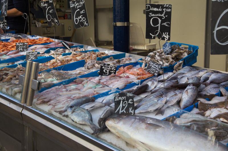 Fish monger across the market